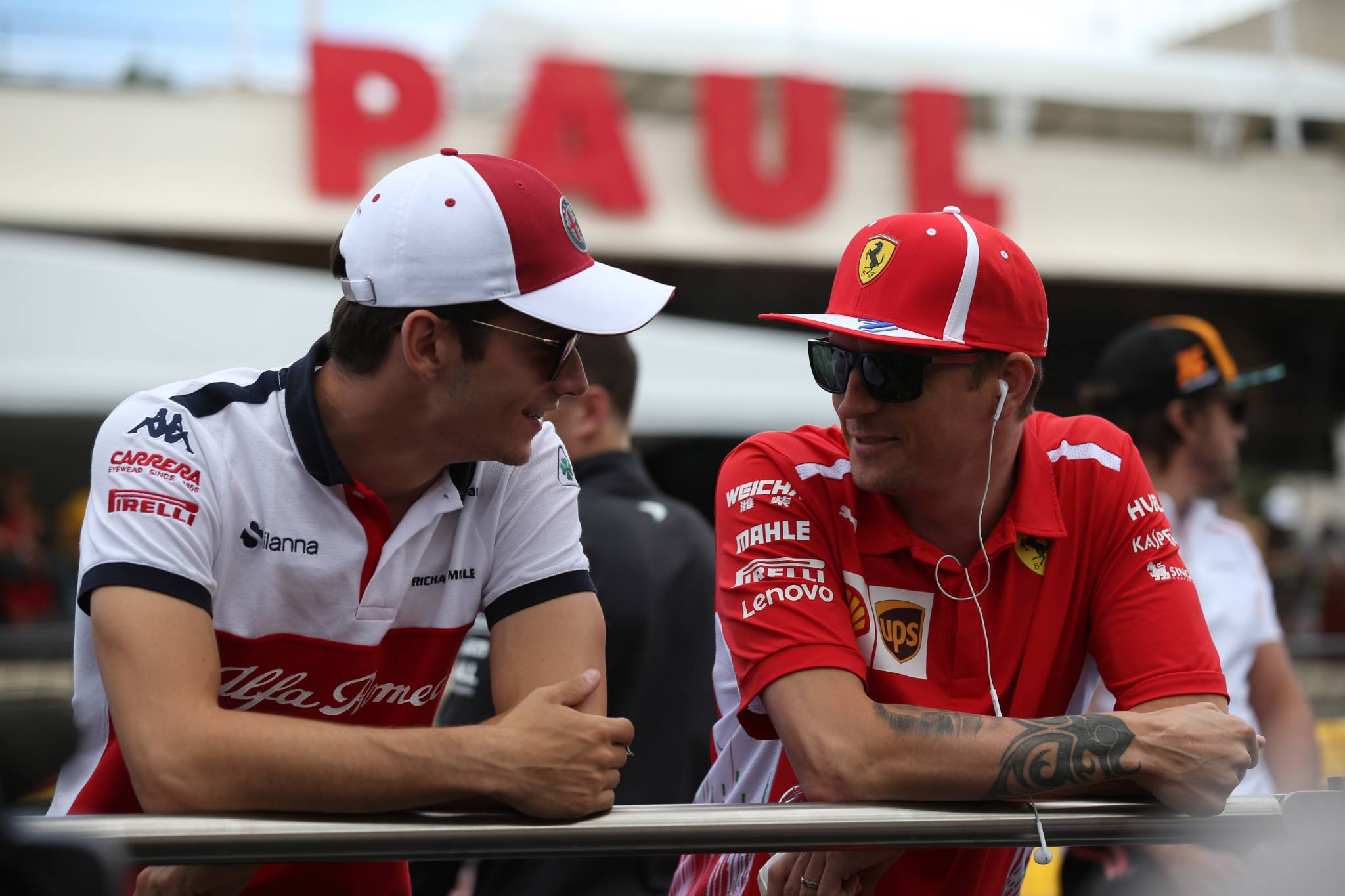 24.06.2018- Driver Parade, Kimi Raikkonen (FIN) Scuderia Ferrari SF71H with Charles Leclerc (GER) Alfa Romeo Sauber C37