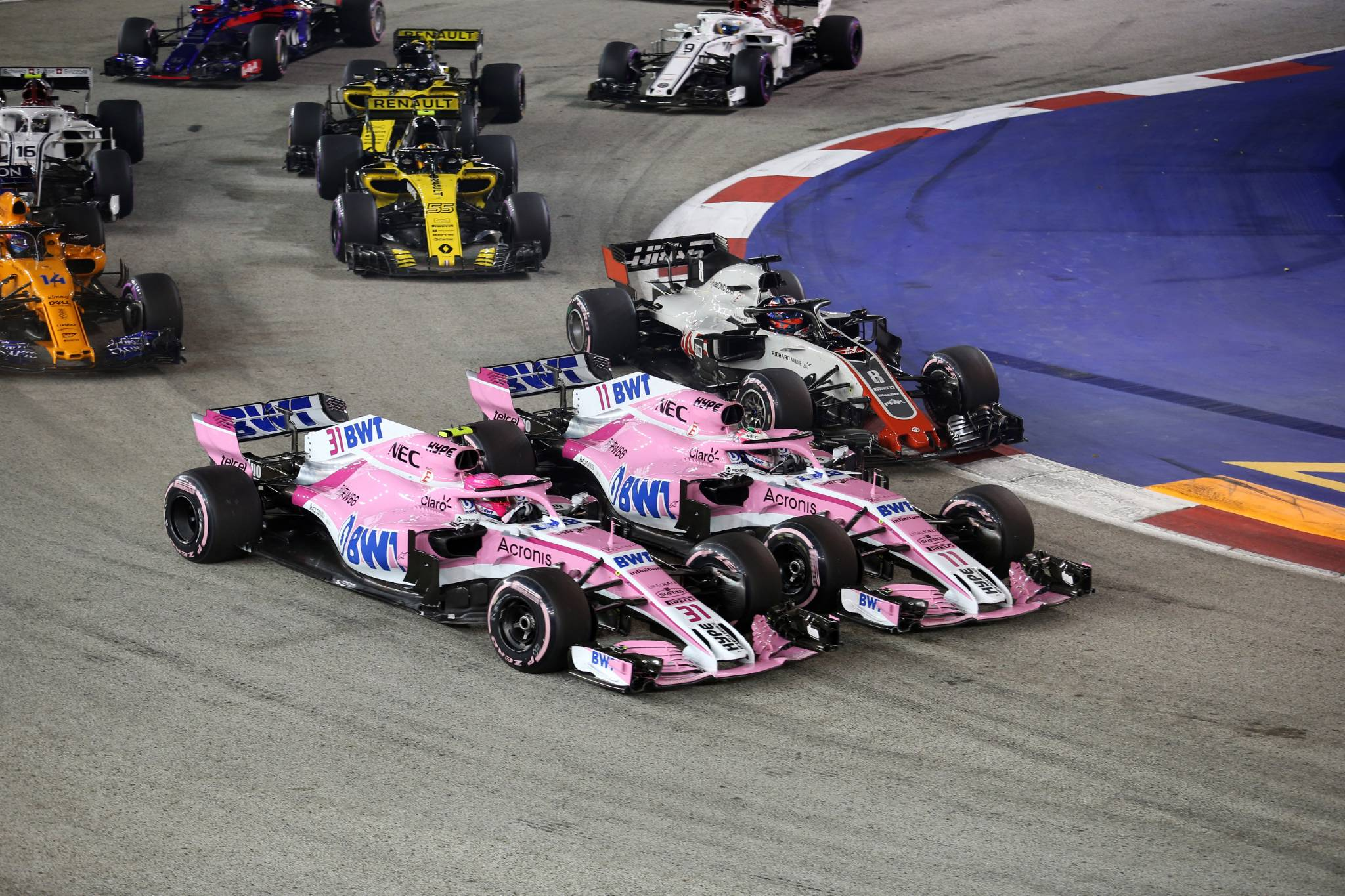 16.09.2018 - Race, Esteban Ocon (FRA) Racing Point Force India F1 VJM11 and Sergio Perez (MEX) Racing Point Force India F1 VJM11
