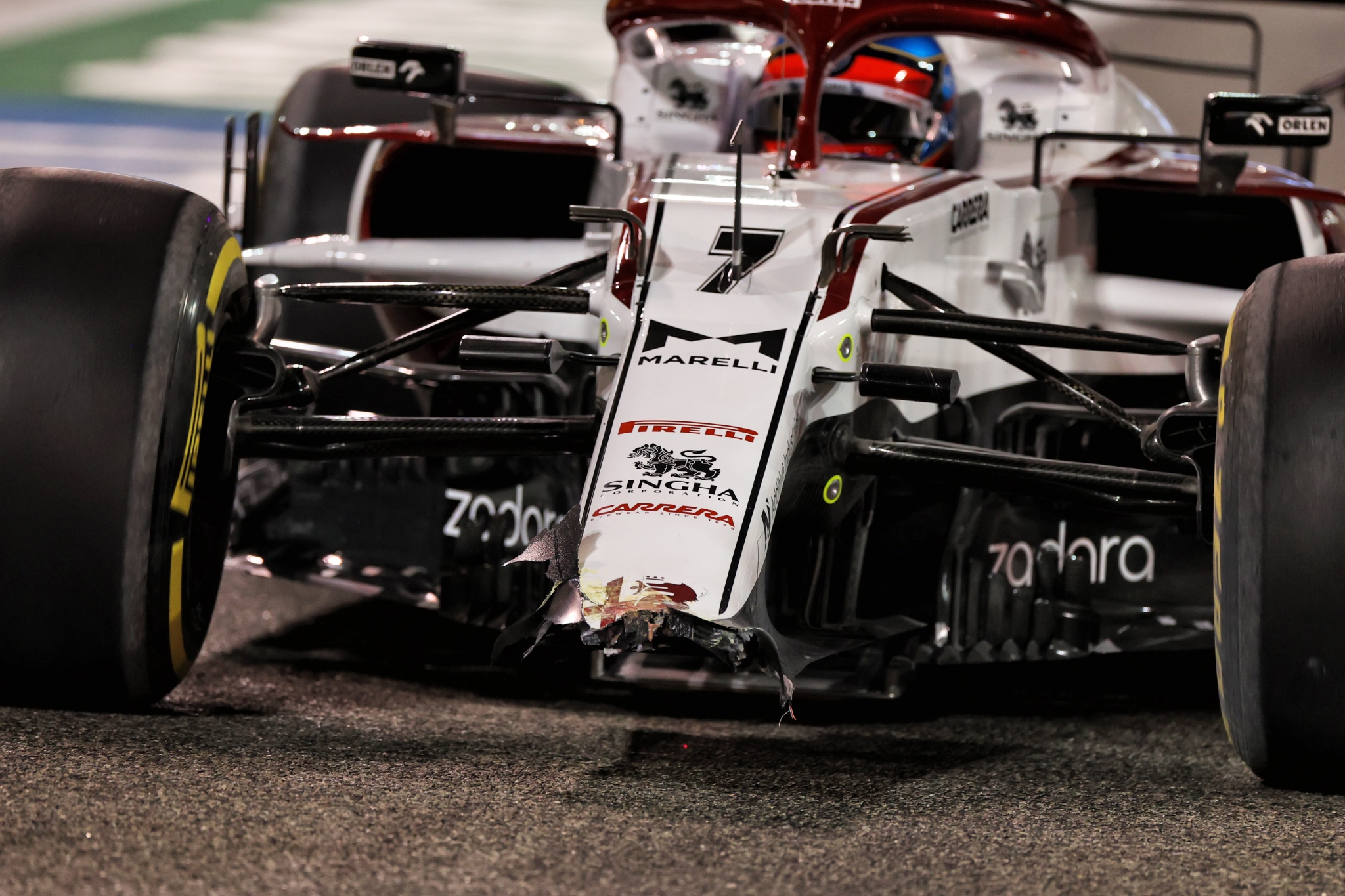 Kimi Raikkonen (FIN) Alfa Romeo Racing C41 with a broken front wing in the second practice session.