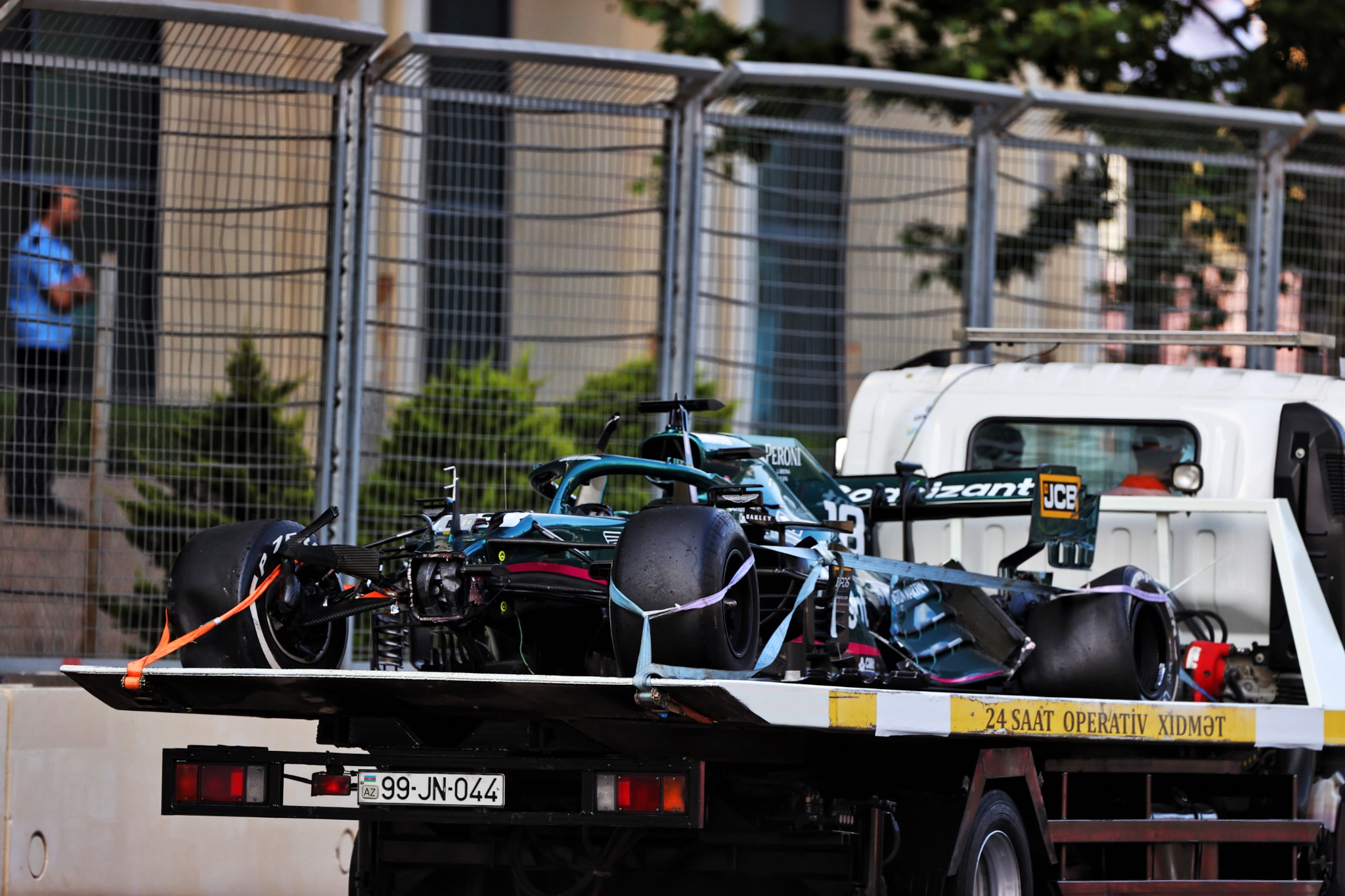 The Aston Martin F1 Team AMR21 of Lance Stroll (CDN) Aston Martin F1 Team is recovered back to the pits on the back of a truck after he crashed out of the race.