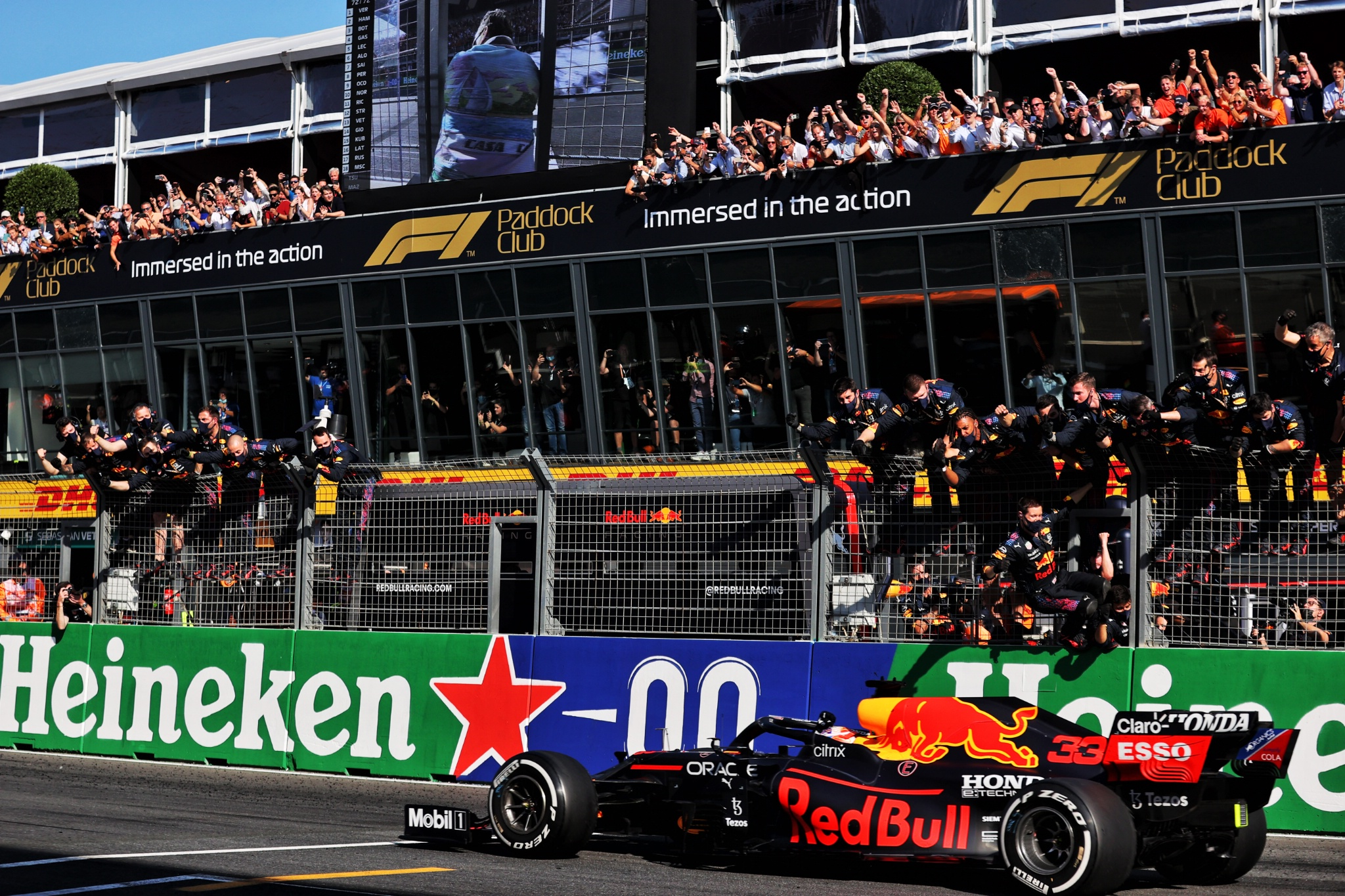 Race winner Max Verstappen (NLD) Red Bull Racing RB16B celebrates as he passes the team at the end of the race.
