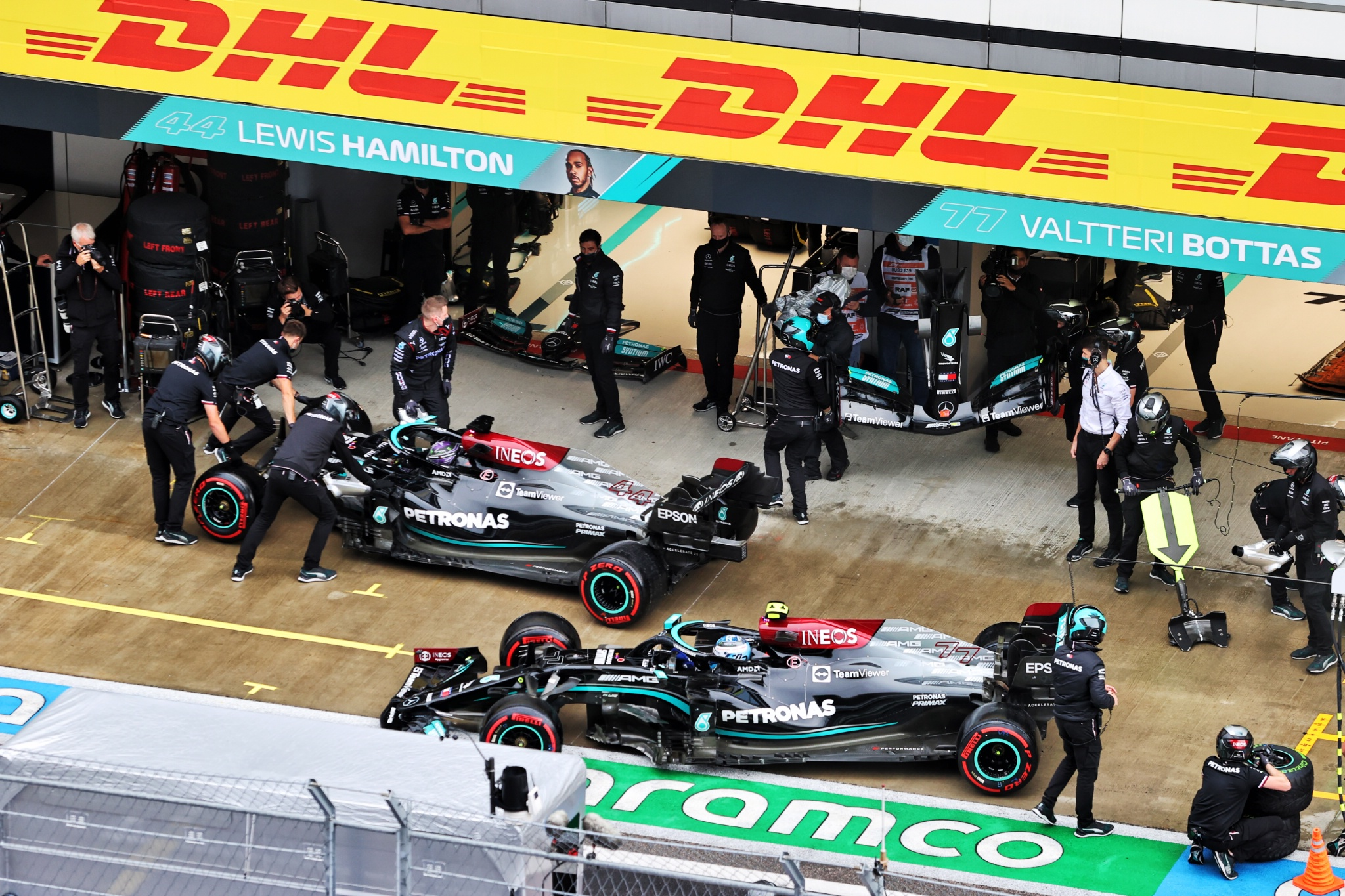 Lewis Hamilton (GBR) Mercedes AMG F1 W12 in the pits with a broken front wing ahead of team mate Valtteri Bottas (FIN) Mercedes AMG F1 W12.