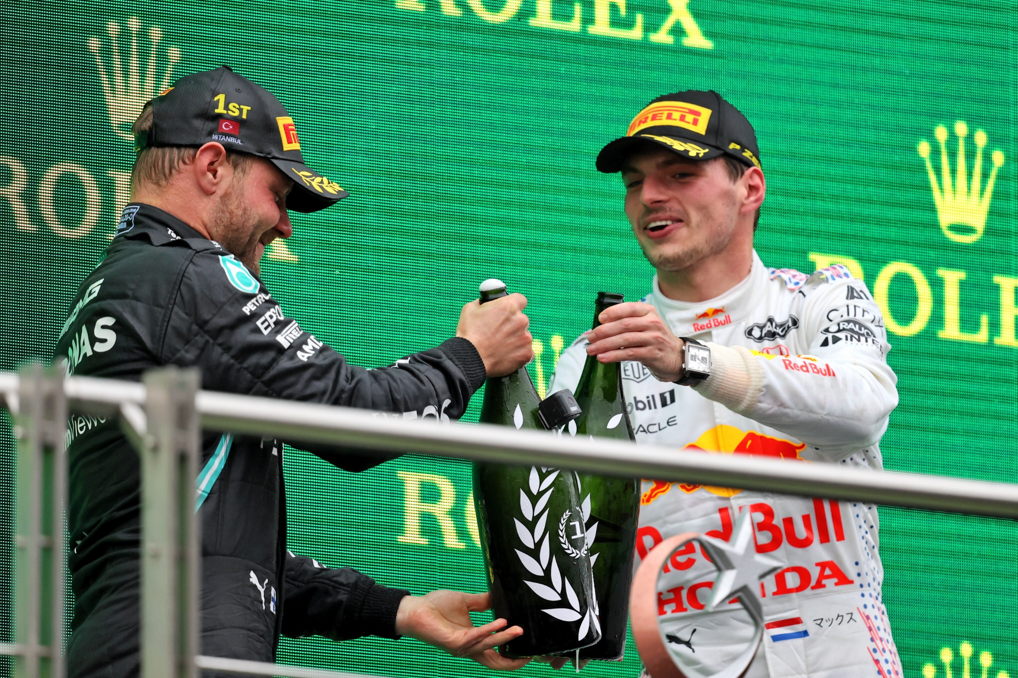 (L to R): Race winner Valtteri Bottas (FIN) Mercedes AMG F1 celebrates on the podium with second placed Max Verstappen (NLD) Red Bull Racing.