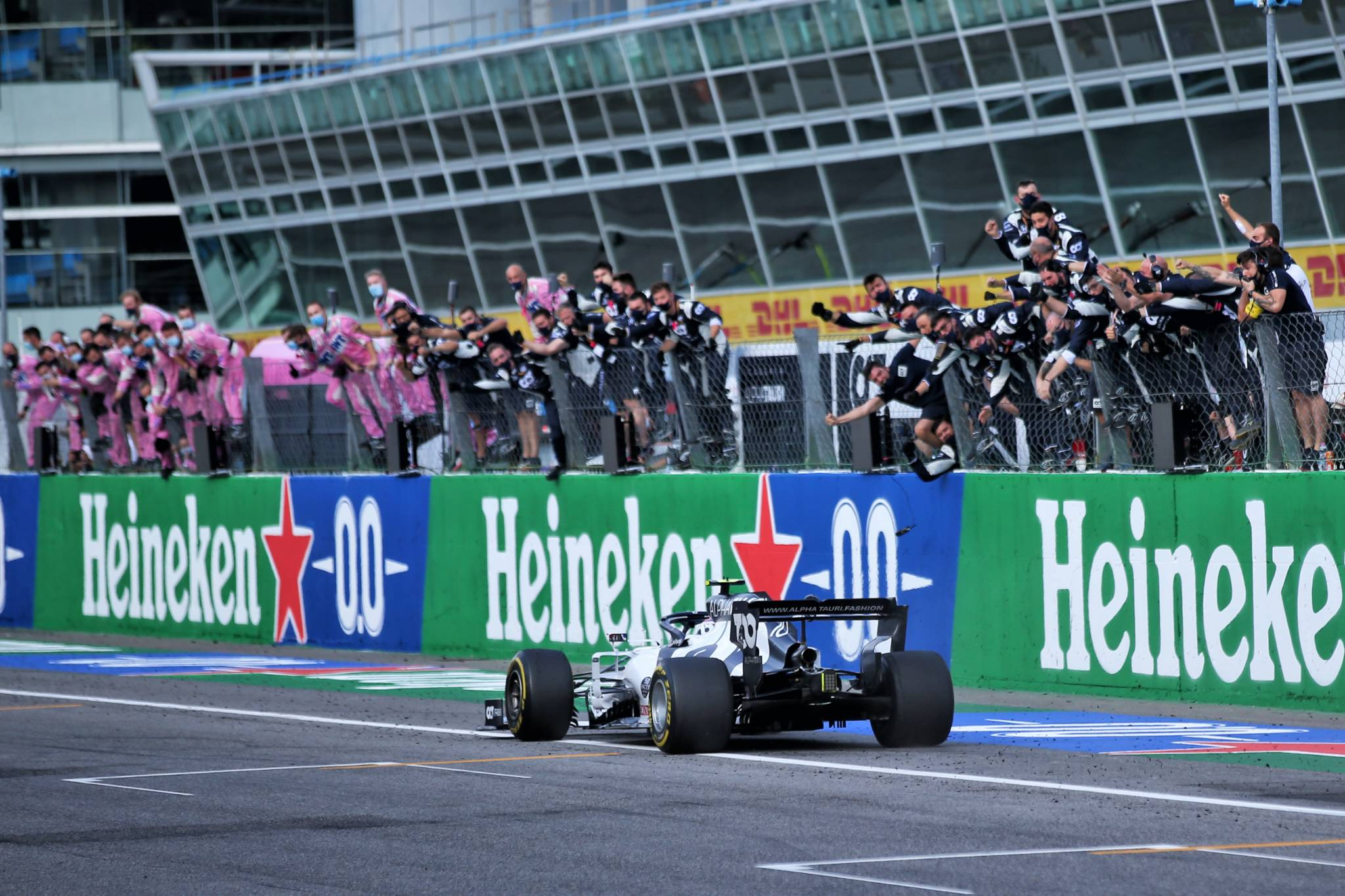 Race winner Pierre Gasly (FRA) AlphaTauri AT01 celebrates as he passes his team at the end of the race.