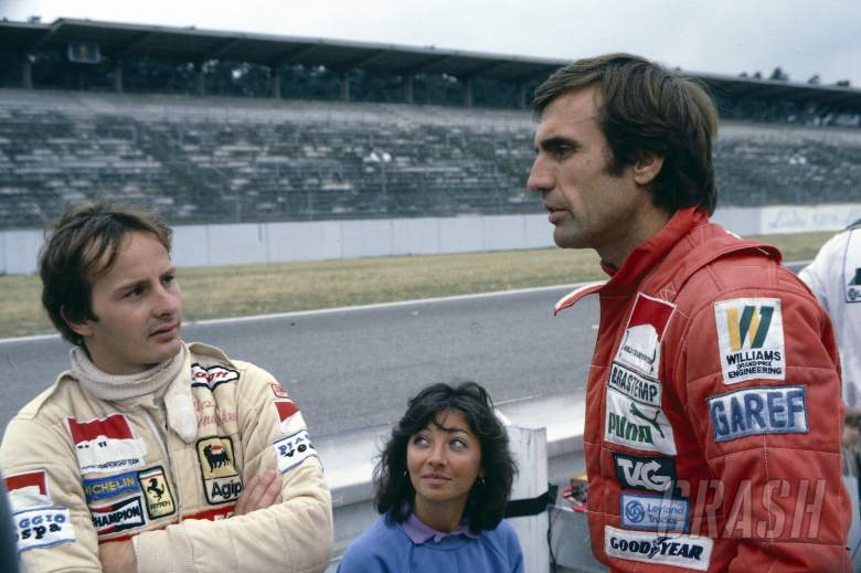 Gilles Villeneuve (CDN) Ferrari with wife Joan talks with Carlos Reutemann (ARG) Williams