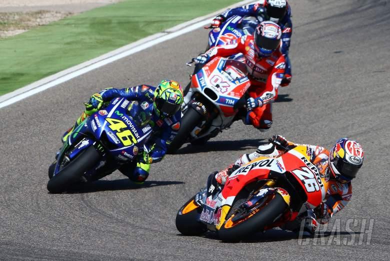 Rossi, Pedrosa disagree over close pass