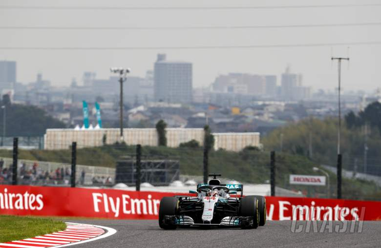 Hamilton takes Japan F1 pole as Ferrari blunder leaves Vettel 9th