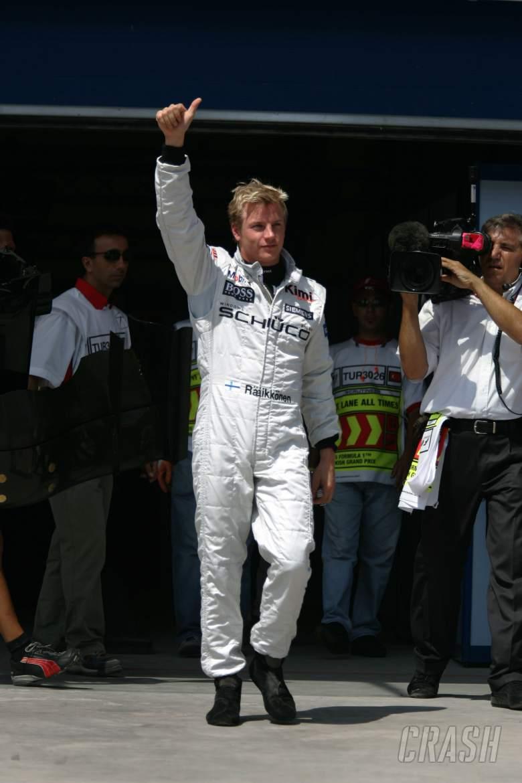 Kimi Raikkonen celebrates after taking pole position for the Turkish GP