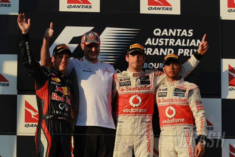 2nd place Sebastian Vettel (GER), Red Bull Racing with 1st place Jenson Button (GBR), McLaren Merced