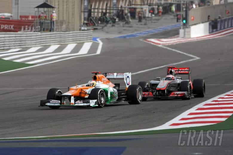 22.04.2012- Race, Paul di Resta (GBR) Sahara Force India F1 Team VJM05 and Jenson Button (GBR) McLar