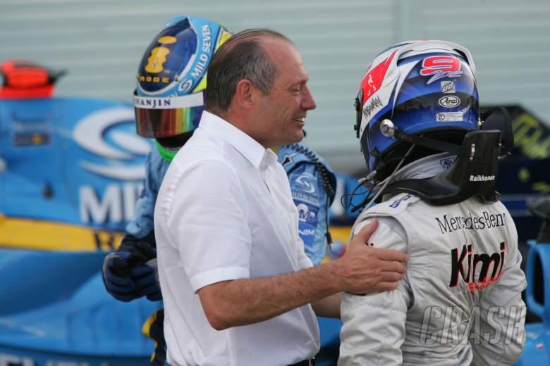 McLaren boss Ron Dennis congratulates Kimi Raikkonen on his Japanese Grand Prix win