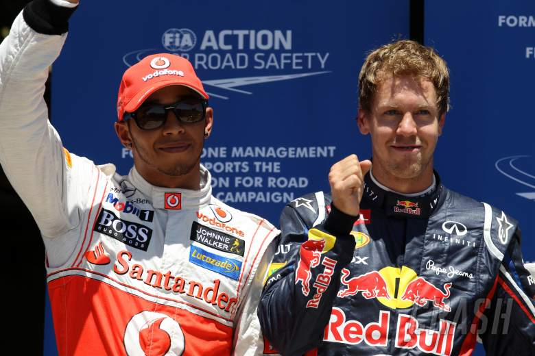 23.06.2012- Qualifying, Sebastian Vettel (GER) Red Bull Racing RB8 pole position and Lewis Hamilton