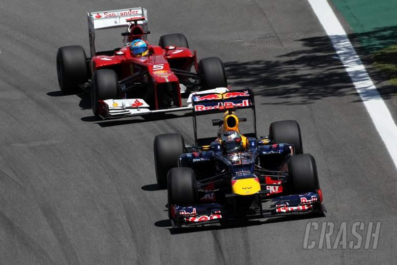 23.11.2012- Free Practice 2, Sebastian Vettel (GER) Red Bull Racing RB8 and Fernando Alonso (ESP) Sc