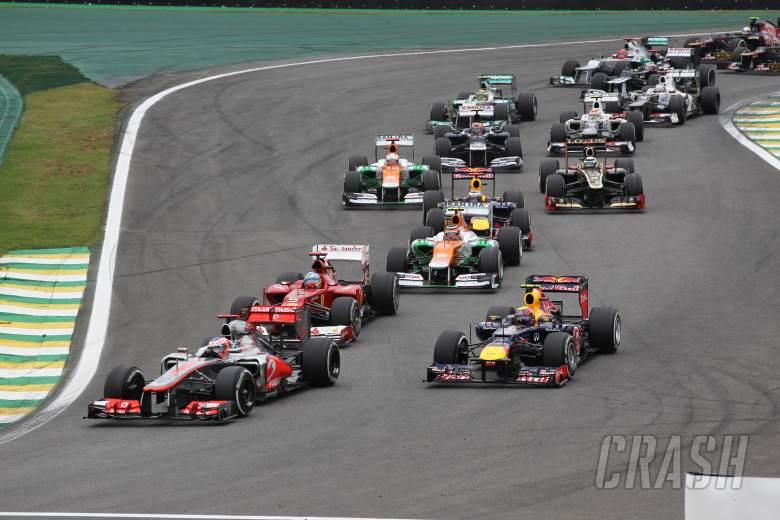 25.11.2012- Race, Start of the race, Jenson Button (GBR) McLaren Mercedes MP4-27 and Mark Webber (AU