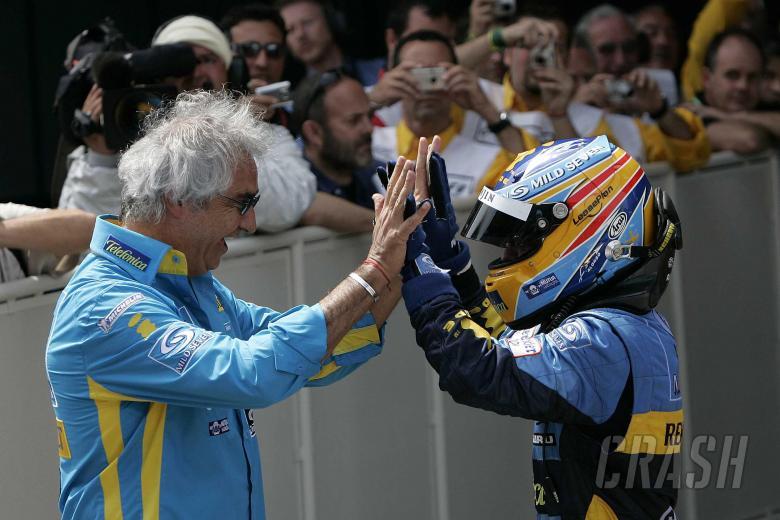 Renault`s Fernando Alonso celebrates his Spanish GP win with team boss, Flavio Briatore