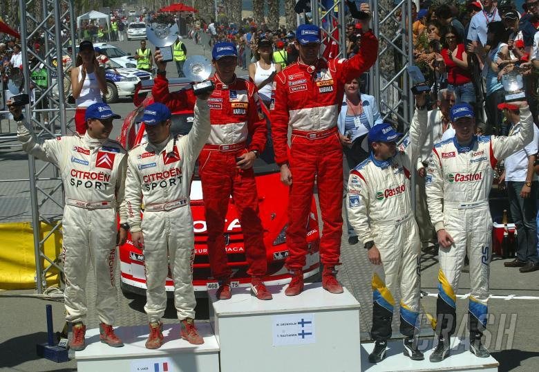 Cyprus Rally winners, Marcus Gronholm and Timo Rautiainen on the podium with Sebastian Loeb and Dani