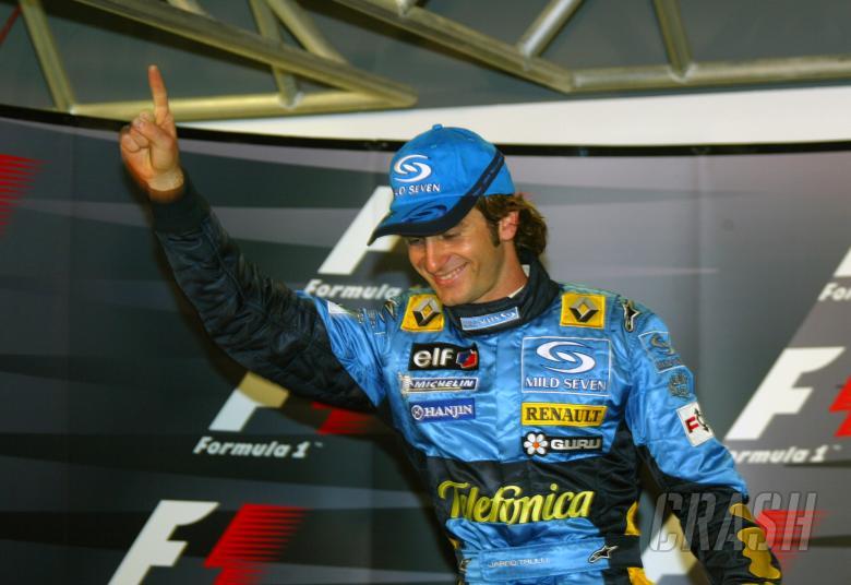 Jarno Trulli celebrates his first pole position at the 2004 Monaco Grand Prix