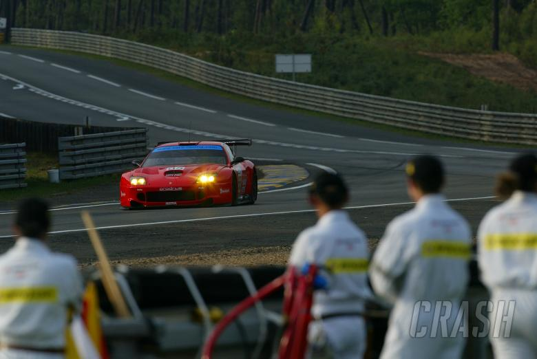 Corner workers watch Prodrive Ferrari at Le Mans
