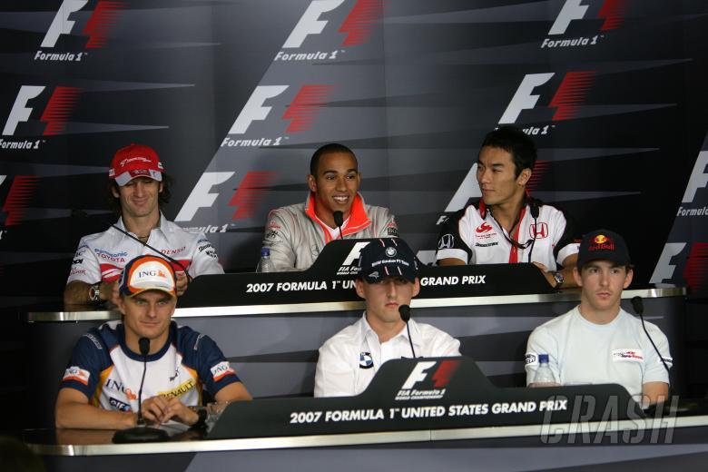 Jarno Trulli (ITA) Toyota TF107, Lewis Hamilton (GBR) McLaren MP4/22, Takuma Sato (JPN) Super Aguri