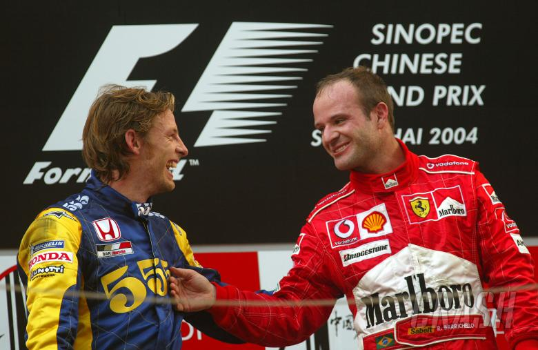 Rubens Barrichello jokes with Jenson Button on the Chinese Grand Prix podium