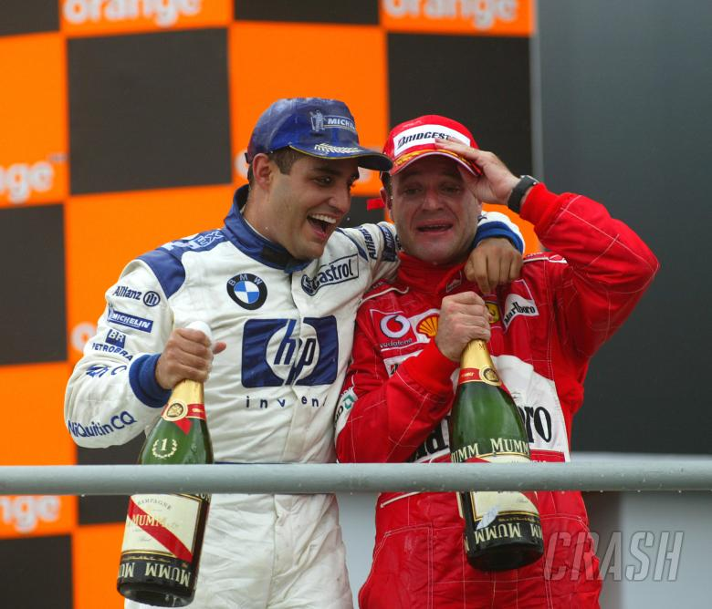 Juan Pablo Montoya and Rubens Barrichello celebrate at Interlagos