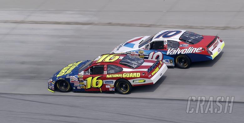 Greg Biffle edges Scott Riggs into turn 1 at the Dover International Speedway.