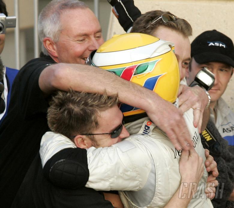 Manor boss John Booth leads the congratulations for Bahrain Superprix winner Lewis Hamilton