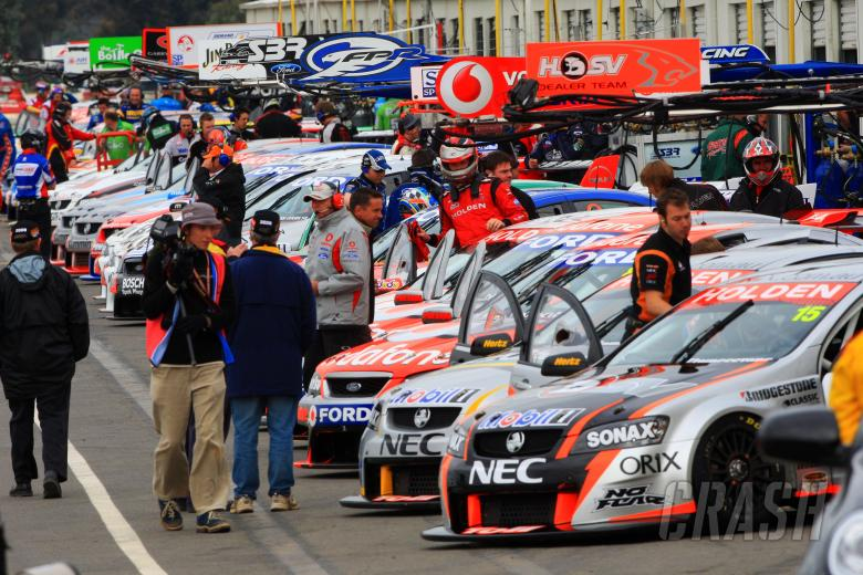 Garth Tander (aust) Toll HRT Commodore climb into his car on the pre grid in pit laneV8 Supercars Rd