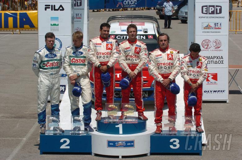 Acropolis Rally winners, Sebastien Loeb and Daniel Elena on the podium  with Toni Gardemeister and J
