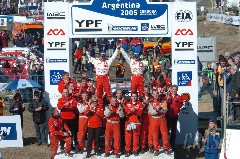 Sebastien Loeb and co-driver, Daniel Elena celebrate with the rest of the Citroen team after winning