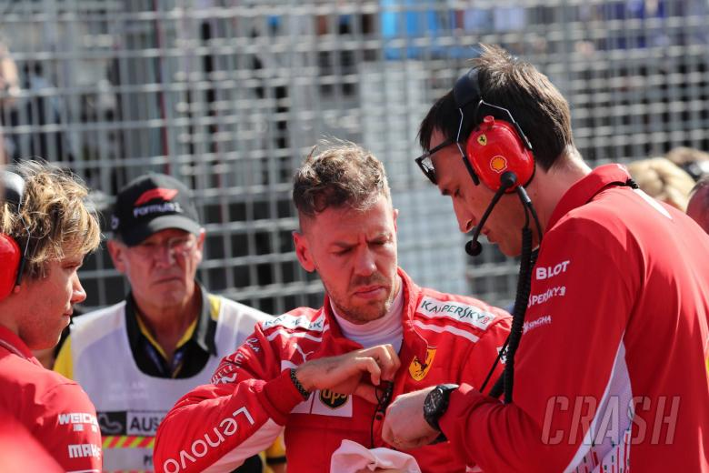 """Vettel """"confused"""" by F1 race start switch, grid girl drops"""