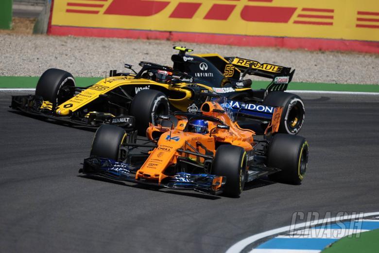 20.07.2018 - Free Practice 2, Carlos Sainz Jr (ESP) Renault Sport F1 Team RS18 and Fernando Alonso (ESP) McLaren MCL33