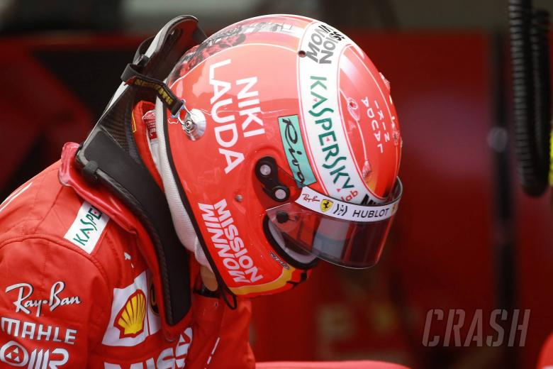 23.05.2019 - Free Practice 2, Sebastian Vettel (GER) Scuderia Ferrari SF90 with a helmet to pay tribute to Nikki Lauda (AU)