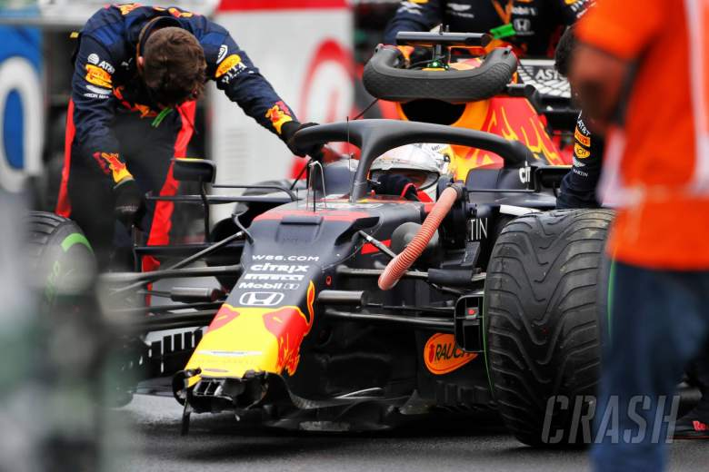 Max Verstappen (NLD) Red Bull Racing RB16 with a broken front wing on the grid.