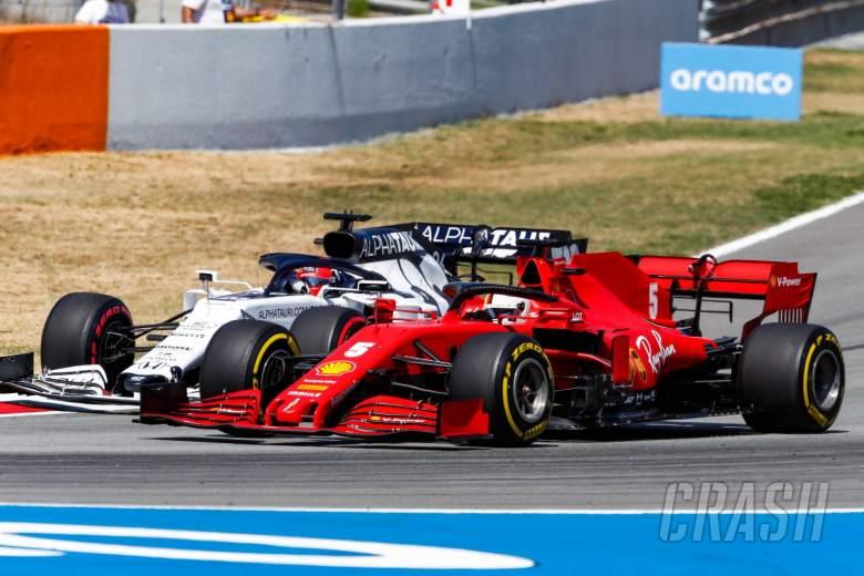 Sebastian Vettel (GER) Ferrari SF1000 and Daniil Kvyat (RUS) AlphaTauri AT01 battle for position.