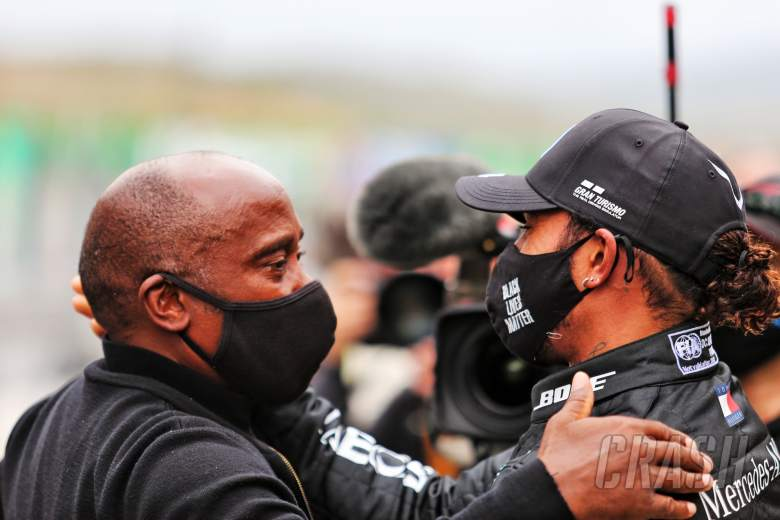 Lewis Hamilton (GBR) Mercedes AMG F1 celebrates his record breaking 92nd Grand Prix victory with his father Anthony Hamilton (GBR).