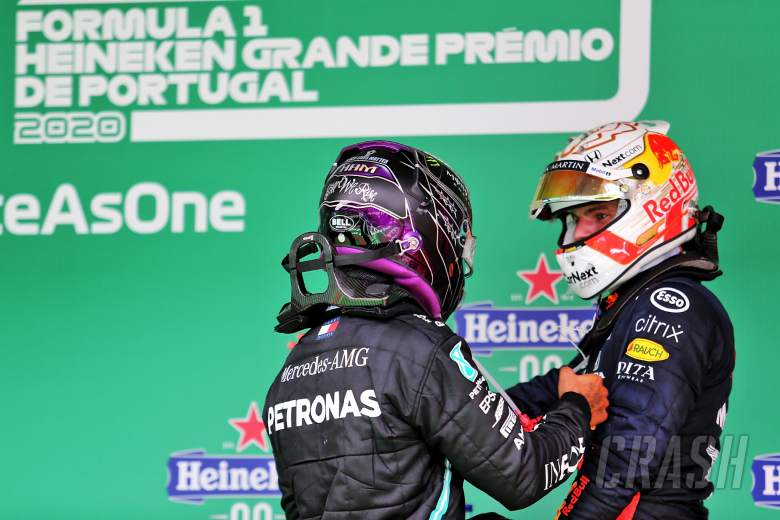 Lewis Hamilton (GBR) Mercedes AMG F1 celebrates his record breaking 92nd Grand Prix victory in parc ferme with Max Verstappen (NLD) Red Bull Racing.