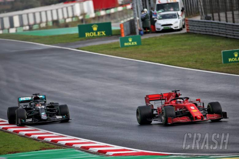 Sebastian Vettel (GER) Ferrari SF1000 and Lewis Hamilton (GBR) Mercedes AMG F1 W11.