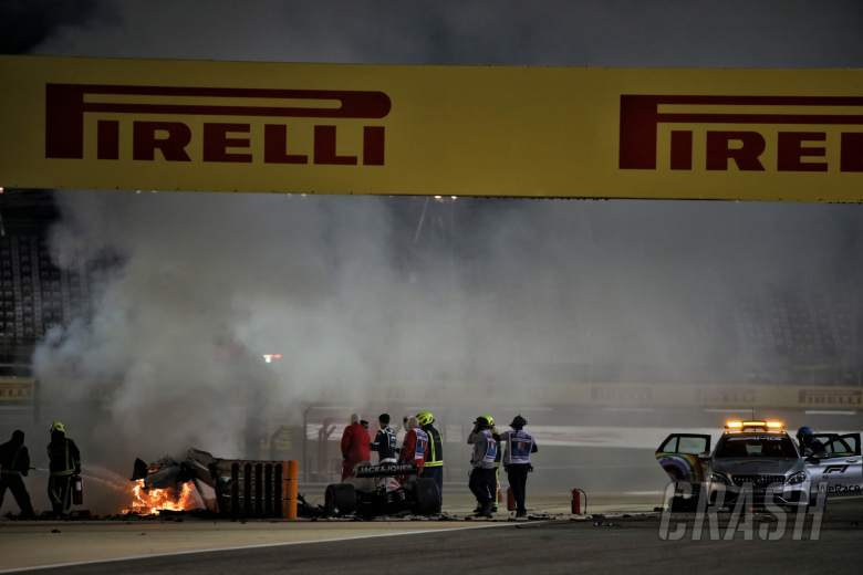 Marshals put out the fire of after Romain Grosjean (FRA) Haas F1 Team VF-20 crashed at the start of the race and exploded into flames.