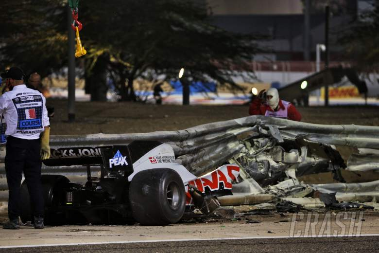 The heavily damaged Haas F1 Team VF-20 of Romain Grosjean (FRA) Haas F1 Team after crashed at the start of the race and exploded into flames, destroying the armco barrier.
