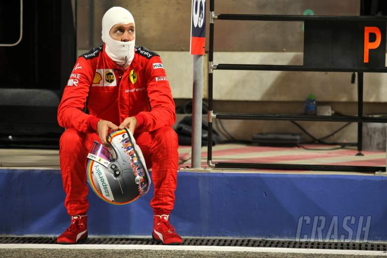 Sebastian Vettel (GER) Ferrari in the pits while the race is stopped.