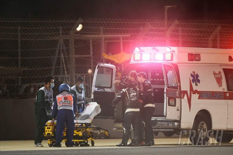 Romain Grosjean (FRA) Haas F1 Team is put into the ambulance by Dr Ian Roberts (GBR) FIA Doctor and Alan Van Der Merwe (RSA) FIA Medical Car Driver.
