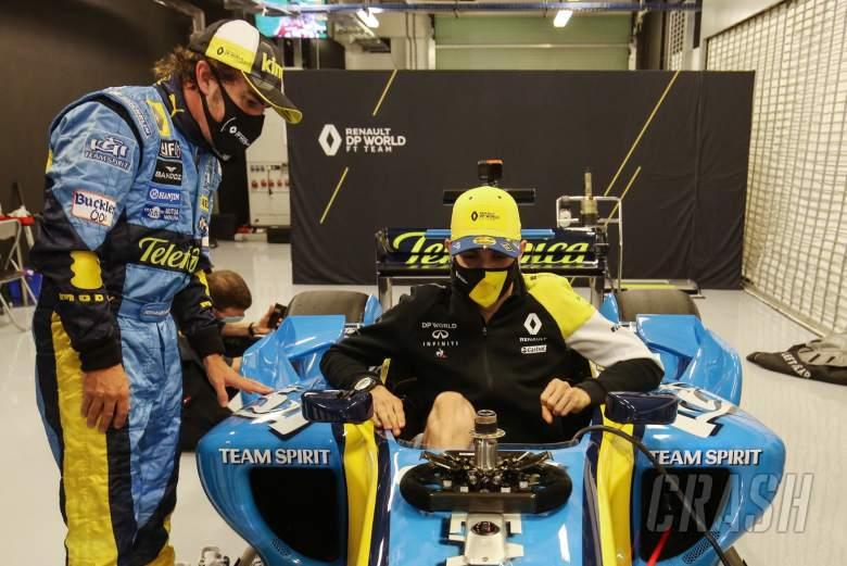 Fernando Alonso (ESP) Renault F1 Team with Esteban Ocon (FRA) Renault F1 Team in the Renault R25.