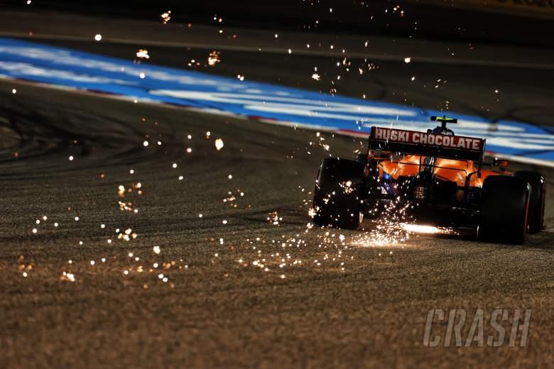 Lando Norris (GBR) McLaren MCL35M sends sparks flying.