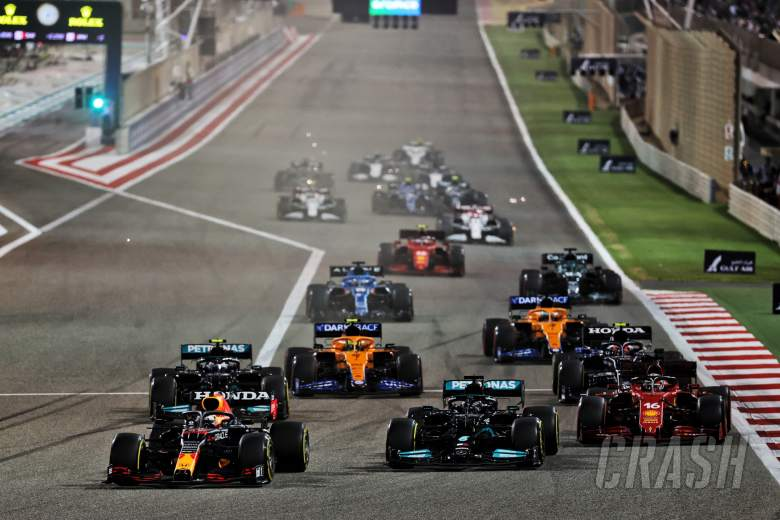Max Verstappen (NLD) Red Bull Racing RB16B leads Lewis Hamilton (GBR) Mercedes AMG F1 W12 and Charles Leclerc (MON) Ferrari SF-21 at the start of the race.