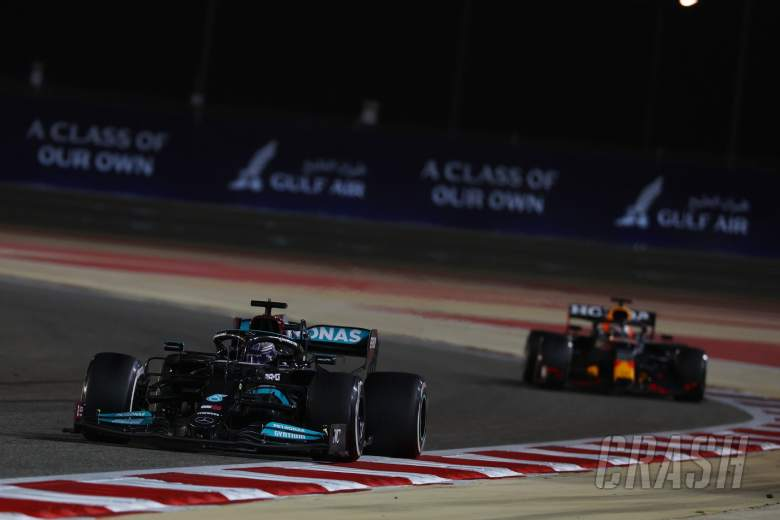 Lewis Hamilton (GBR) Mercedes AMG F1 W12 leads Max Verstappen (NLD) Red Bull Racing RB16B.