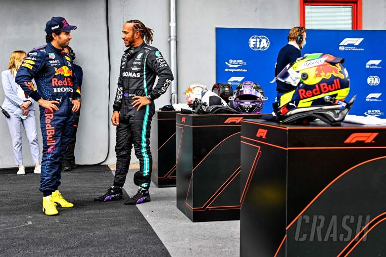(L to R): second placed Sergio Perez (MEX) Red Bull Racing with pole sitter Lewis Hamilton (GBR) Mercedes AMG F1 in qualifying parc ferme.