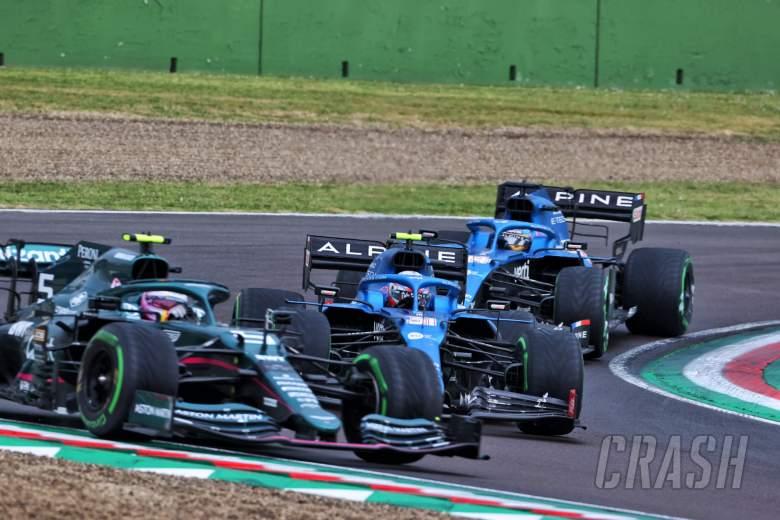 Esteban Ocon (FRA) Alpine F1 Team A521 passes Sebastian Vettel (GER) Aston Martin F1 Team AMR21.