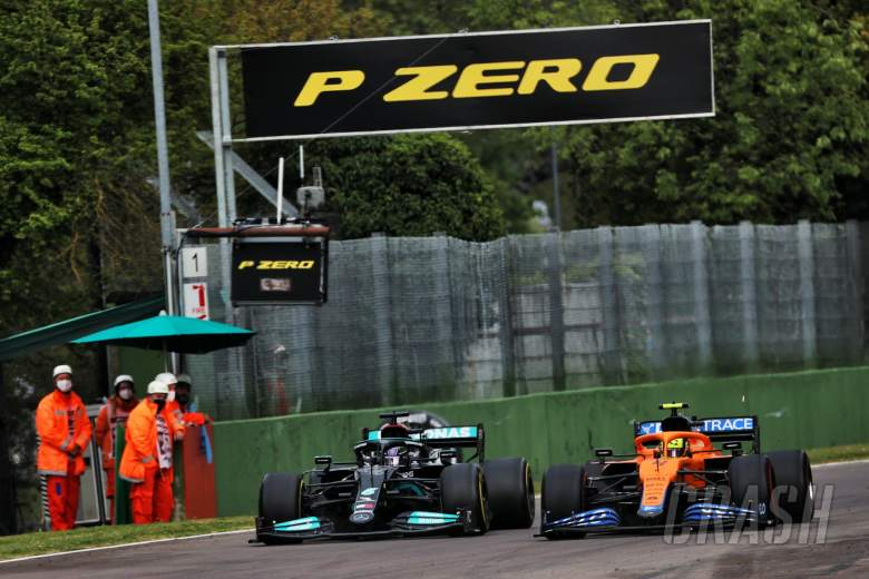 (L to R): Lewis Hamilton (GBR) Mercedes AMG F1 W12 and Lando Norris (GBR) McLaren MCL35M battle for position.