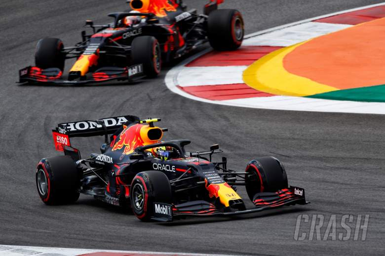 Sergio Perez (MEX) Red Bull Racing RB16B leads team mate Max Verstappen (NLD) Red Bull Racing RB16B.